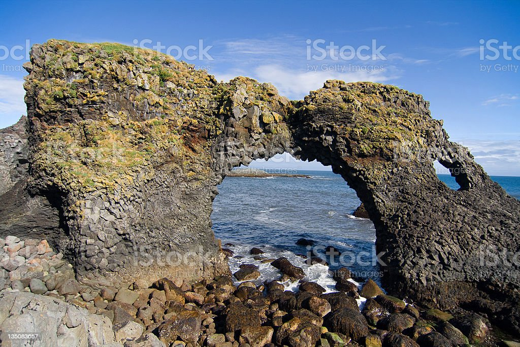 Volcanic rock arch in Iceland stock photo