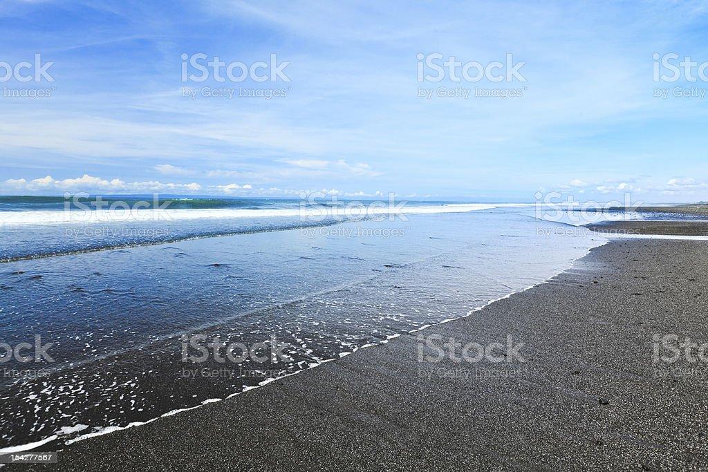Volcanic sand beach stock photo