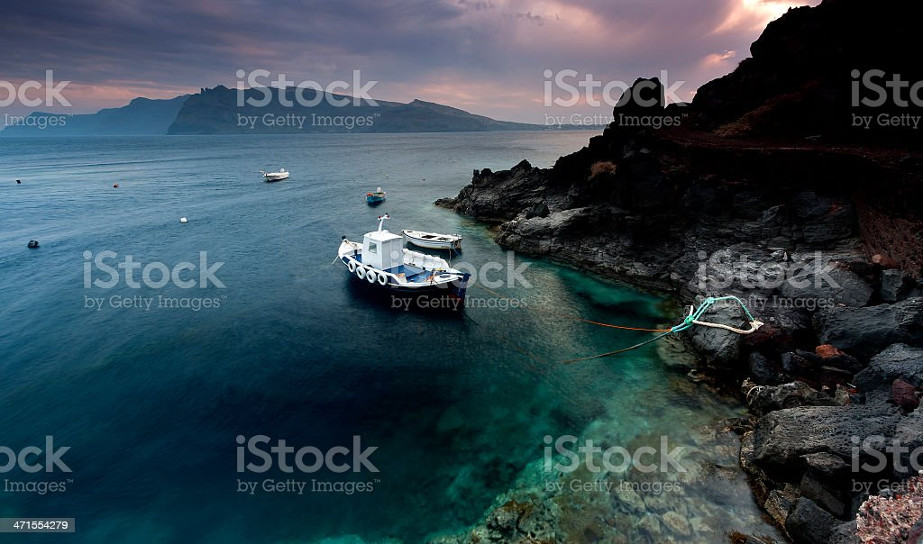 Volcanic seascape in Ammoudi bay. stock photo