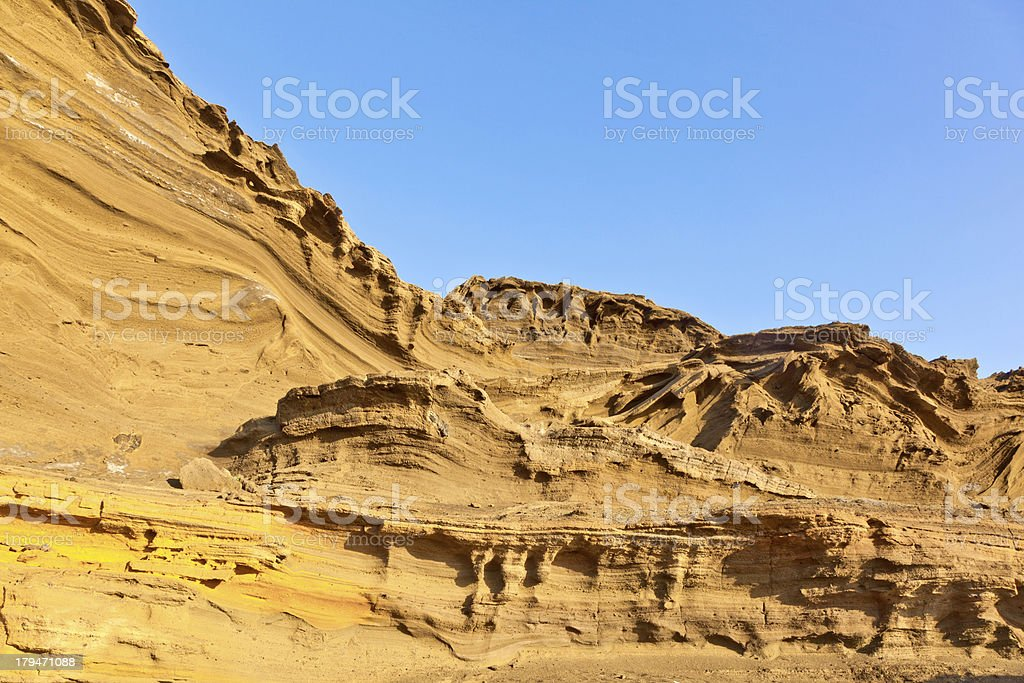 volcanic stone formation with blue sky at el Golfo, Lanzarote royalty-free stock photo