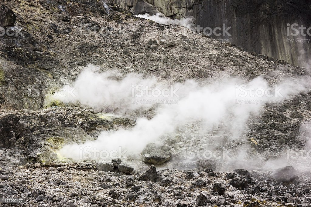 Volcanic vents belch out clouds of  steam and gas royalty-free stock photo