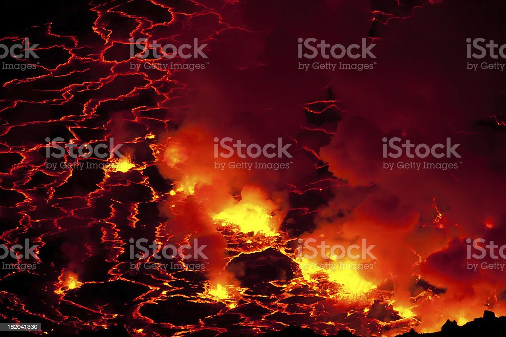 Volcano crater with boiling lava lake stock photo