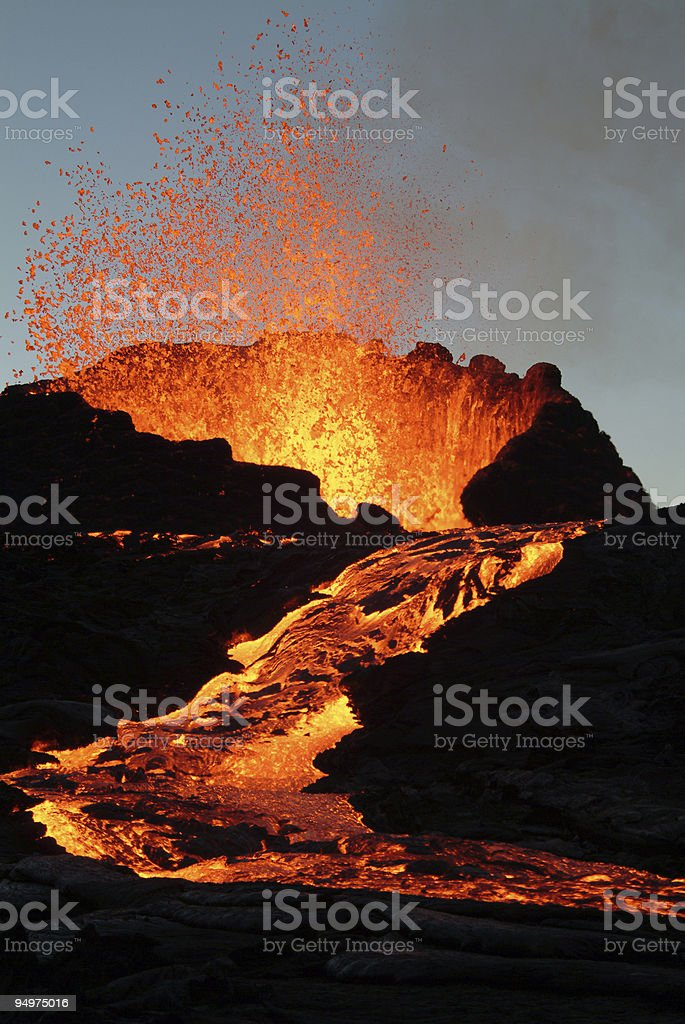 A volcano erupting with hot lava royalty-free stock photo