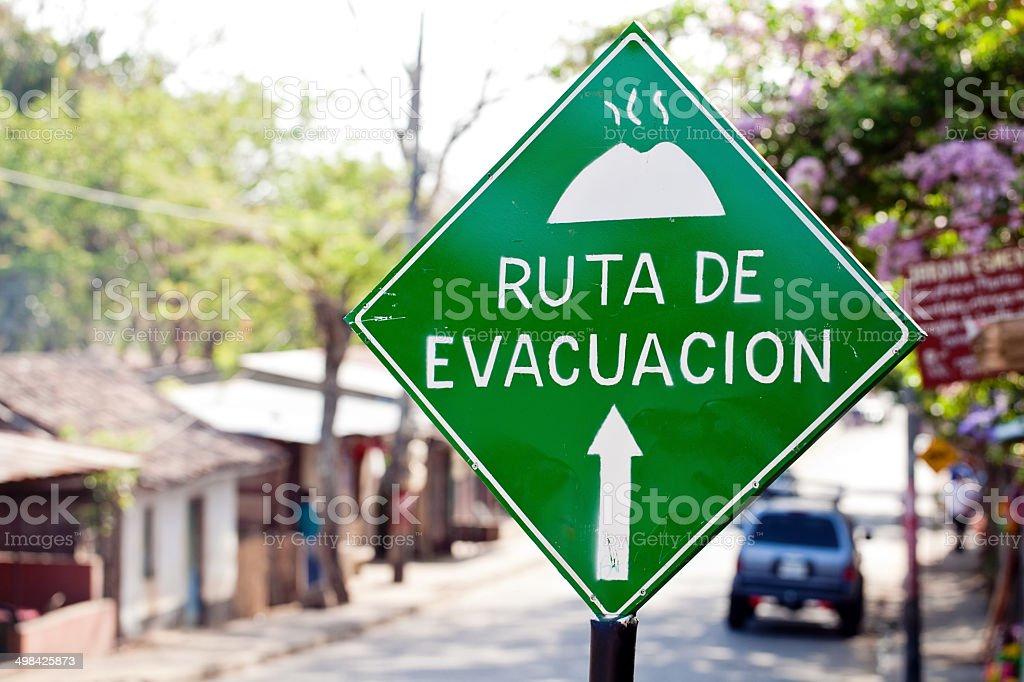 Volcano Evacuation sign in Spanish: ruta de evacuacion stock photo
