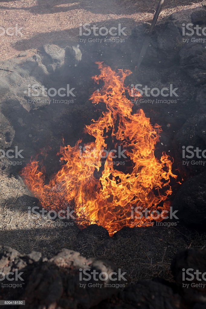 Volcano fire ignited with dry bush stock photo