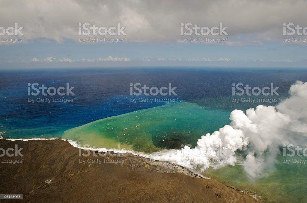 Volcano Lava Flowing from Mt. Kilauea into Sea stock photo