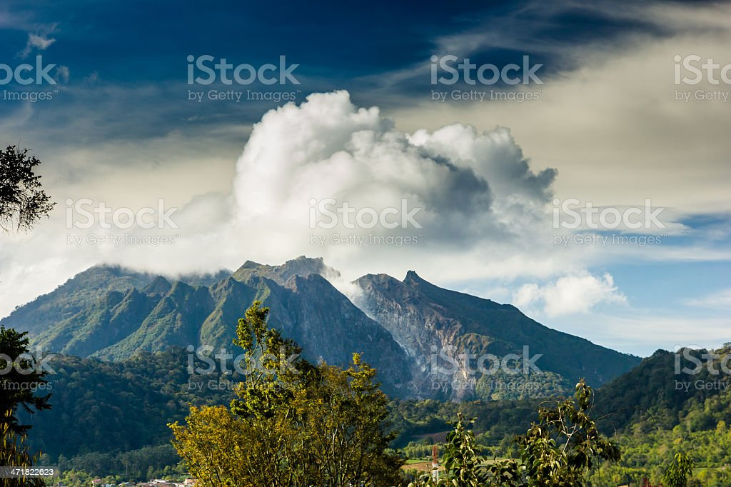 Volcano producing clouds of gas and steam stock photo