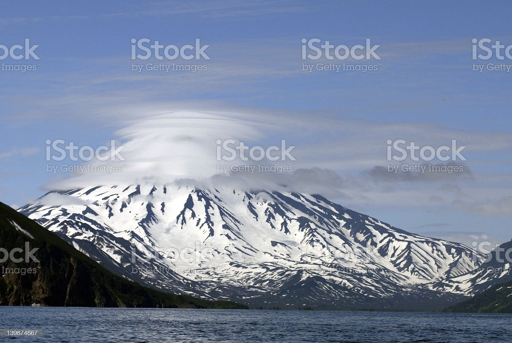 volcano woth clouds royalty-free stock photo