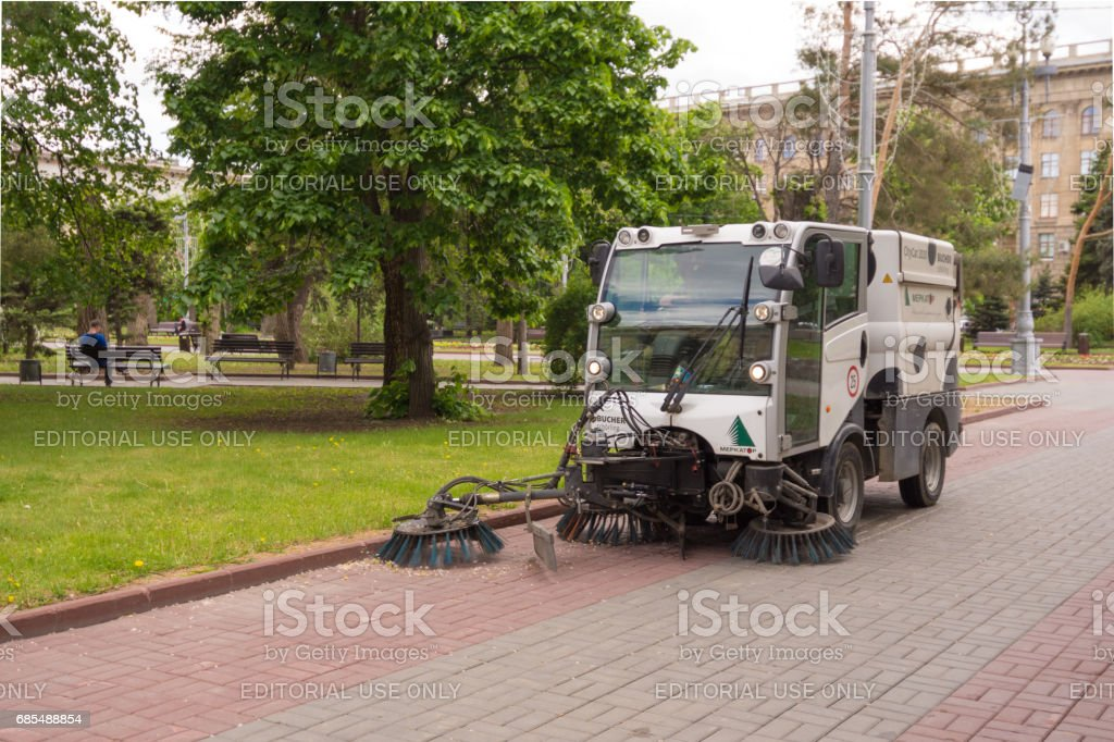 Volgograd. Russia May 11, 2017. The machine cleans the street of debris stock photo