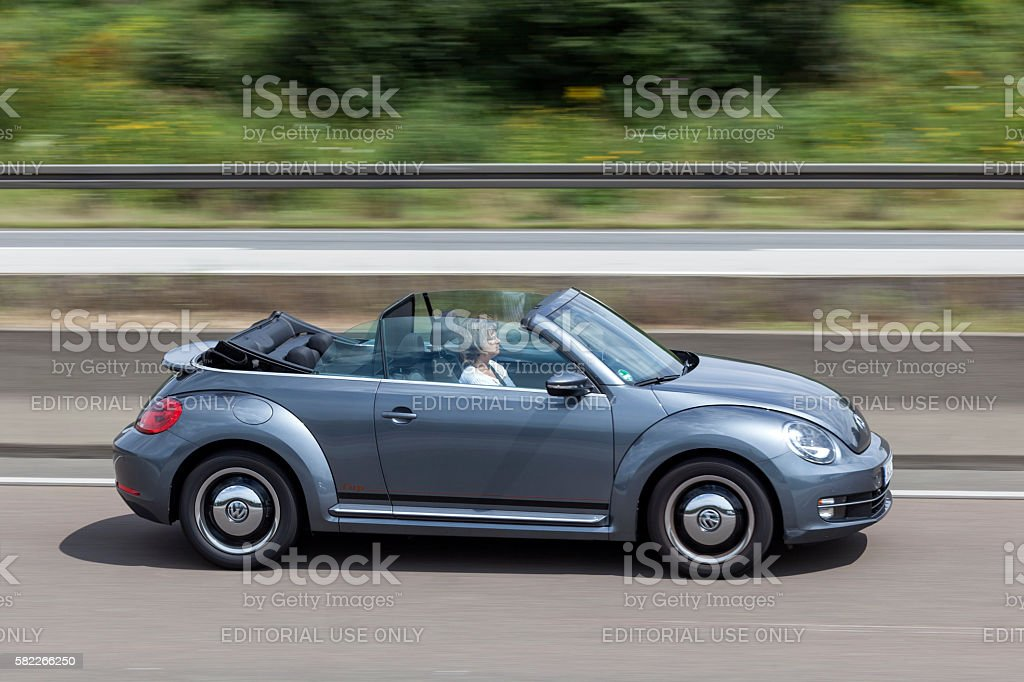 Volkswagen Beetle Convertible on the road stock photo