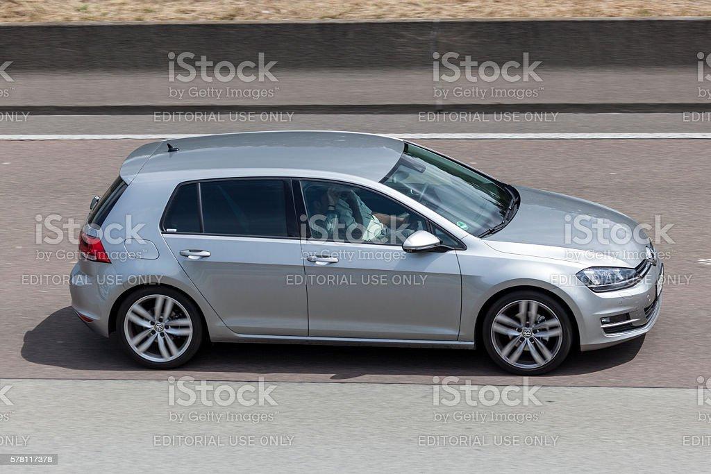 Volkswagen Golf on the road stock photo