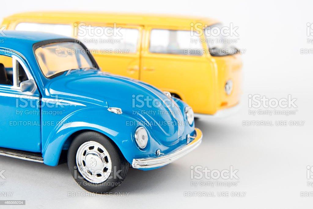 Volkswagen toy Beetle and toy minibus stock photo