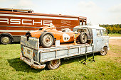 Volkswagen Transporter flatbed classic truck with a Porsche race car