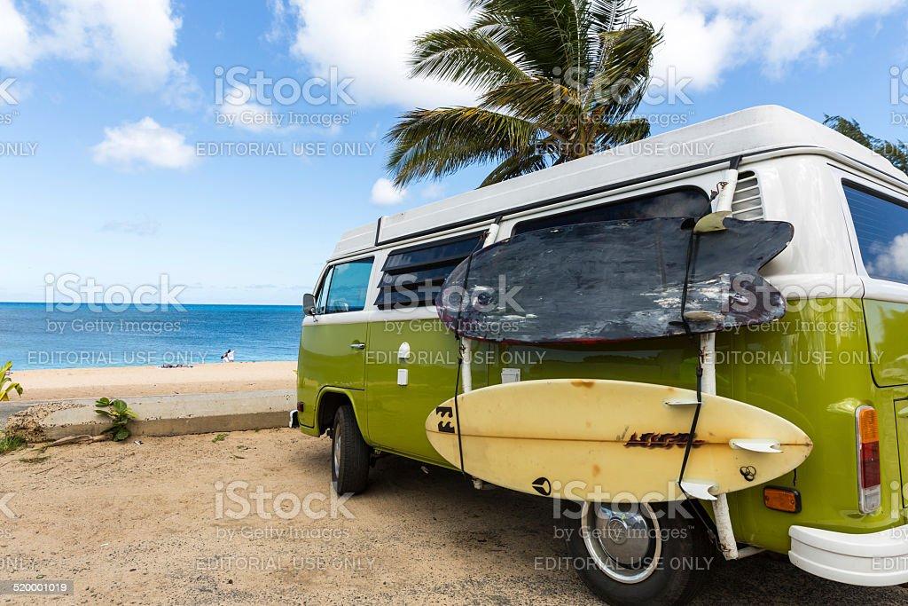 Volkswagen Westfalia Camper Van on Tropical Beach and Surf Boards stock photo