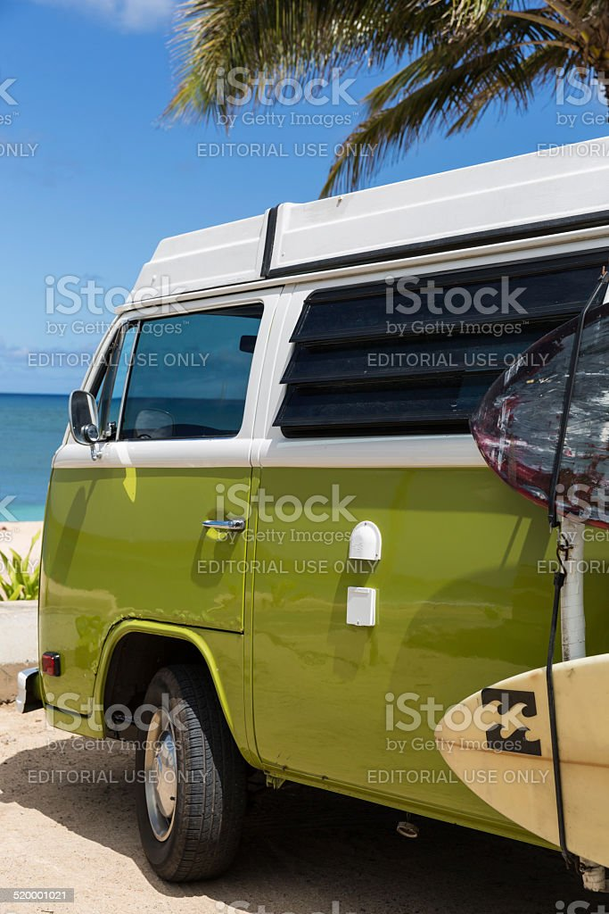 Volkswagen Westfalia Camper Van on Tropical Beach and Surf Boards stock photo