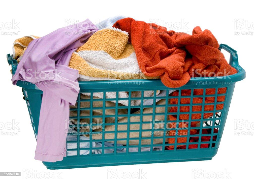 voller Wäschekorb mit Buntwäsche stock photo