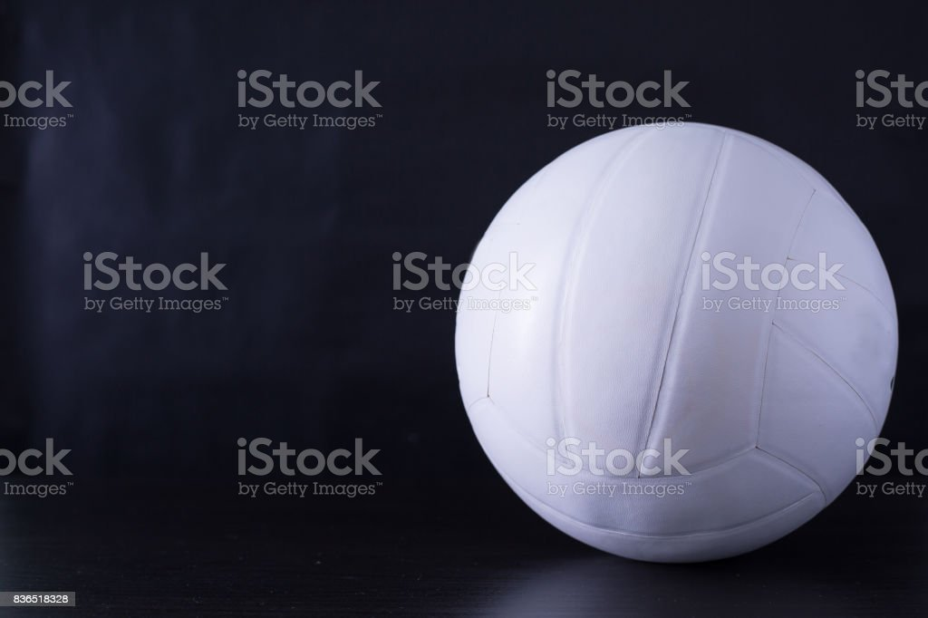 volley ball sport with black ground.