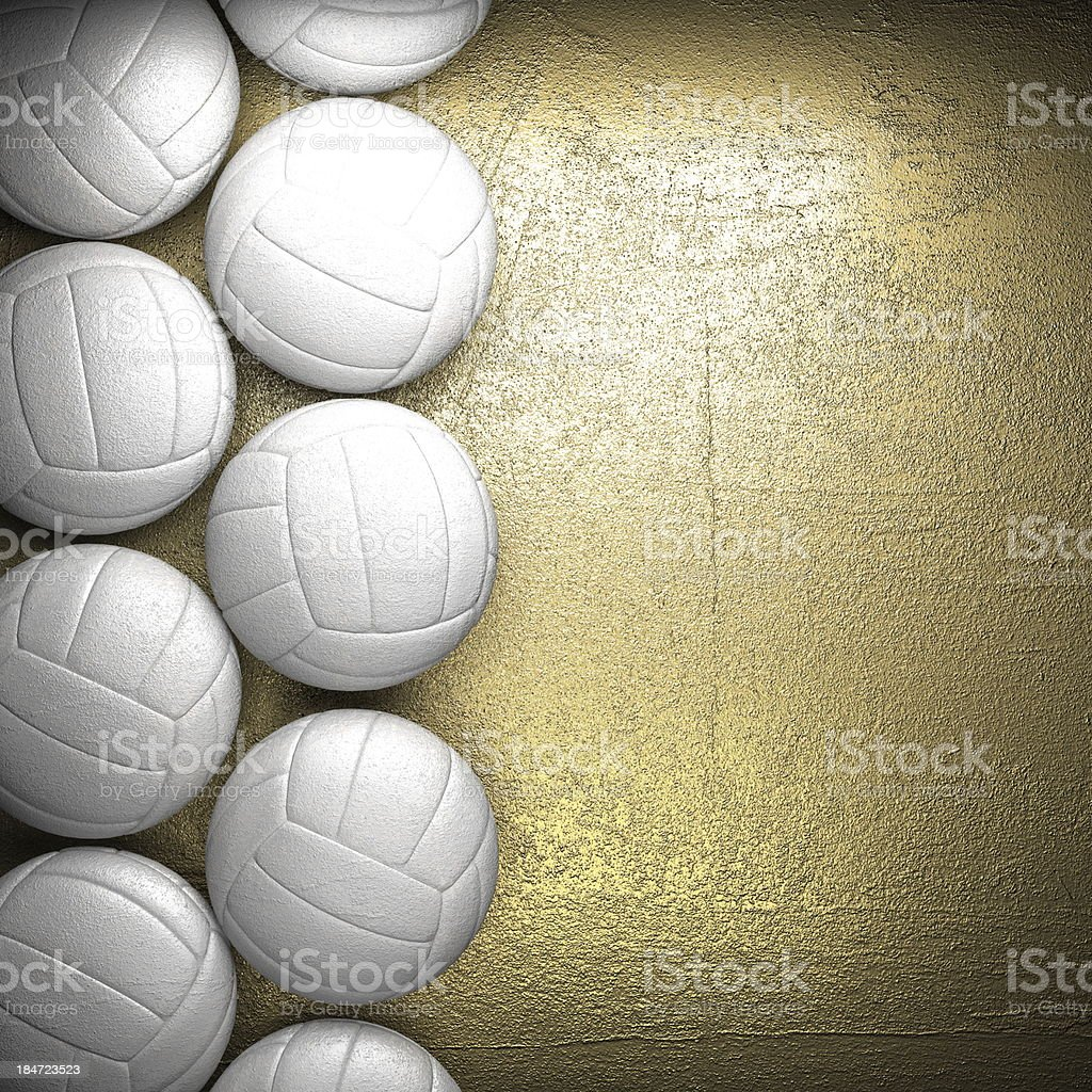 Volleyball ball and golden wall background royalty-free stock photo