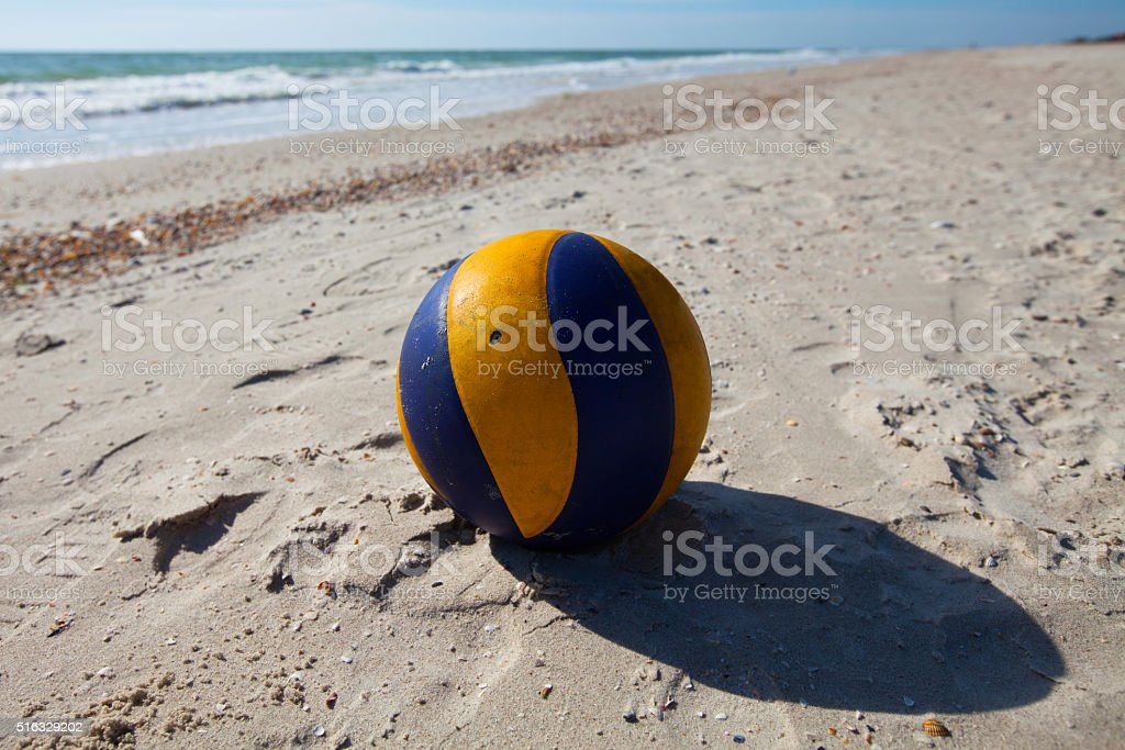 Volleyball ball on the sandy beach stock photo