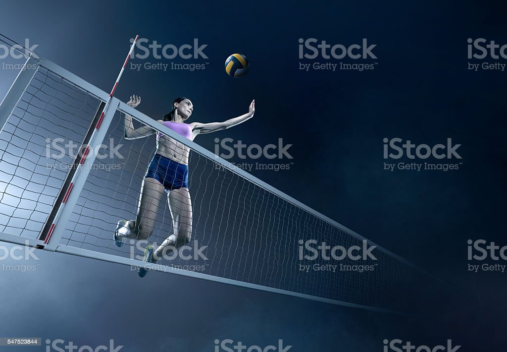 Volleyball: Beautiful female player in action stock photo
