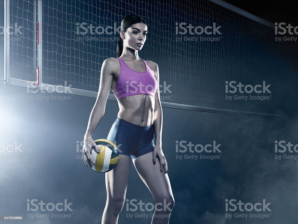 Volleyball: Beautiful female volleyball player stock photo