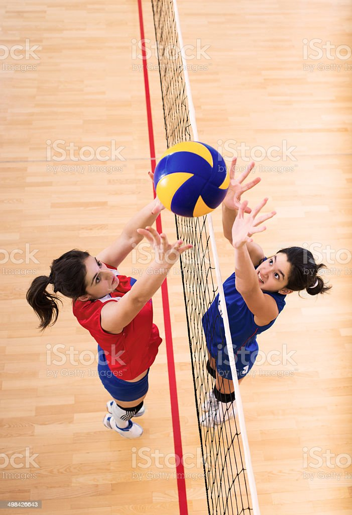 Volleyball block action on the net. stock photo
