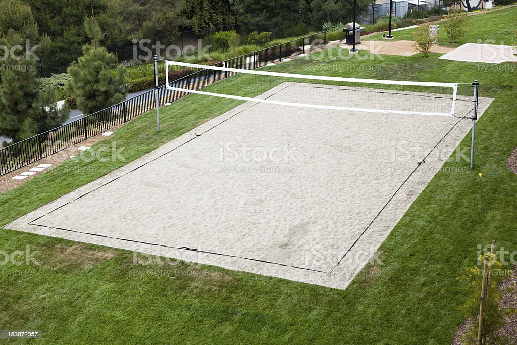Volleyball Court with a green grass  around it stock photo
