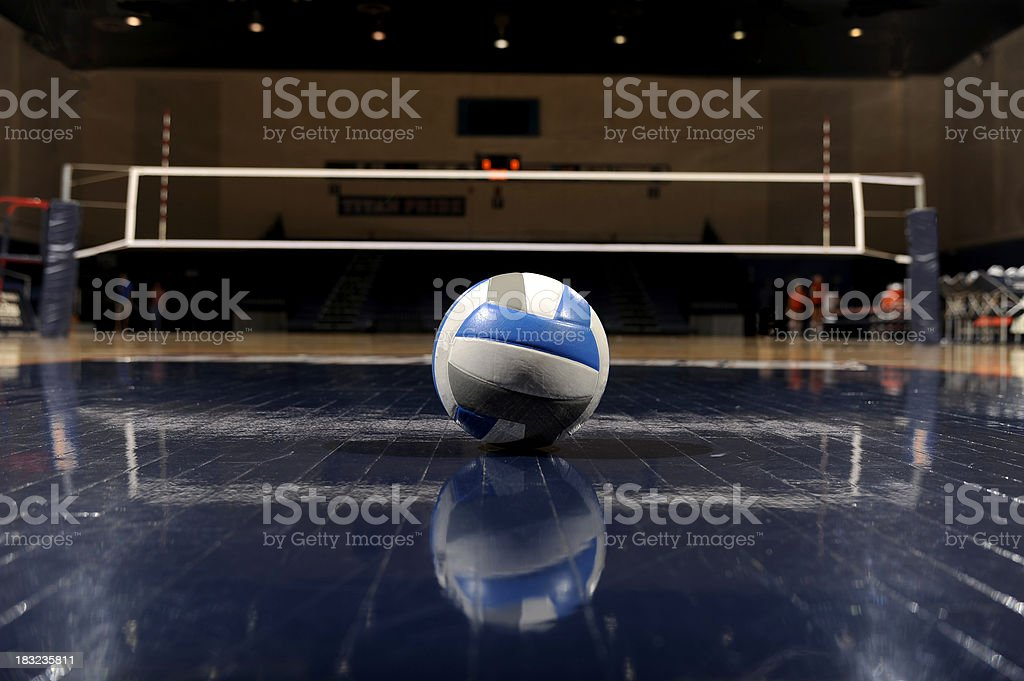 Volleyball in an empty gym stock photo