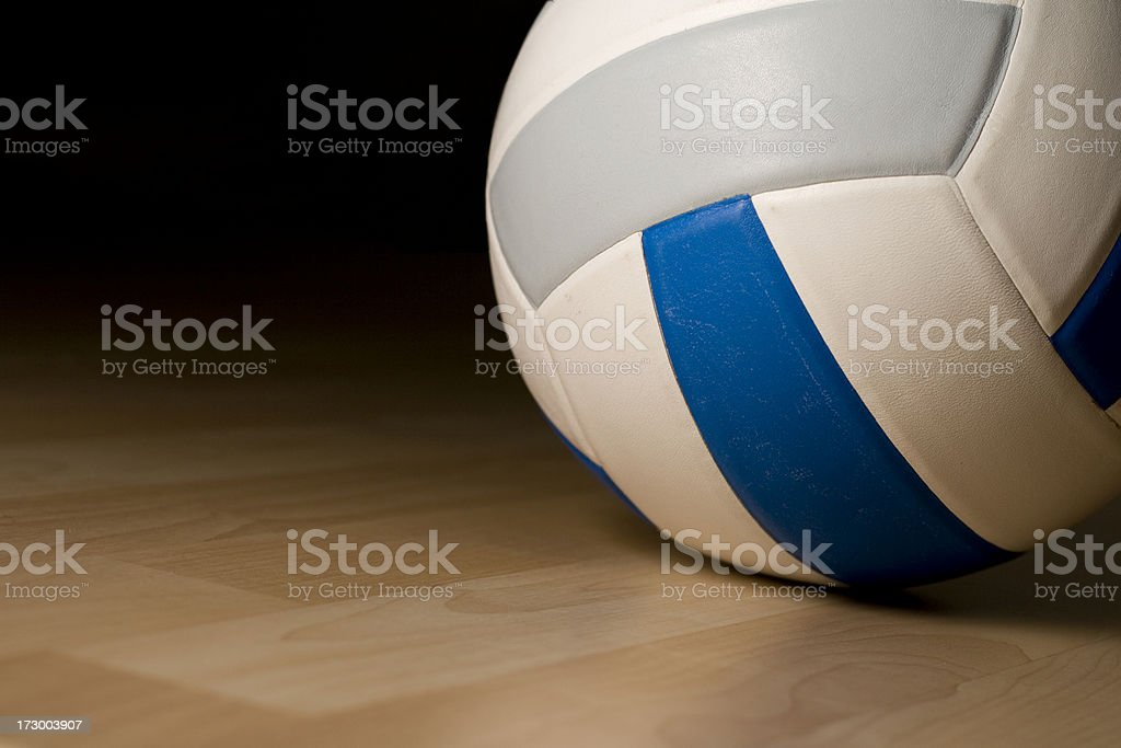 Volleyball in empty gym stock photo