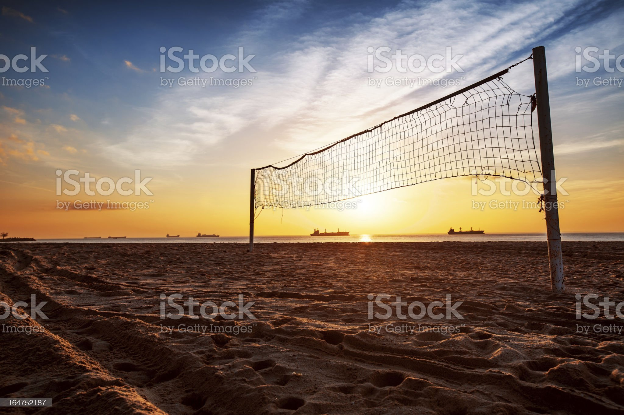 Volleyball net and sunrise on the beach royalty-free stock photo