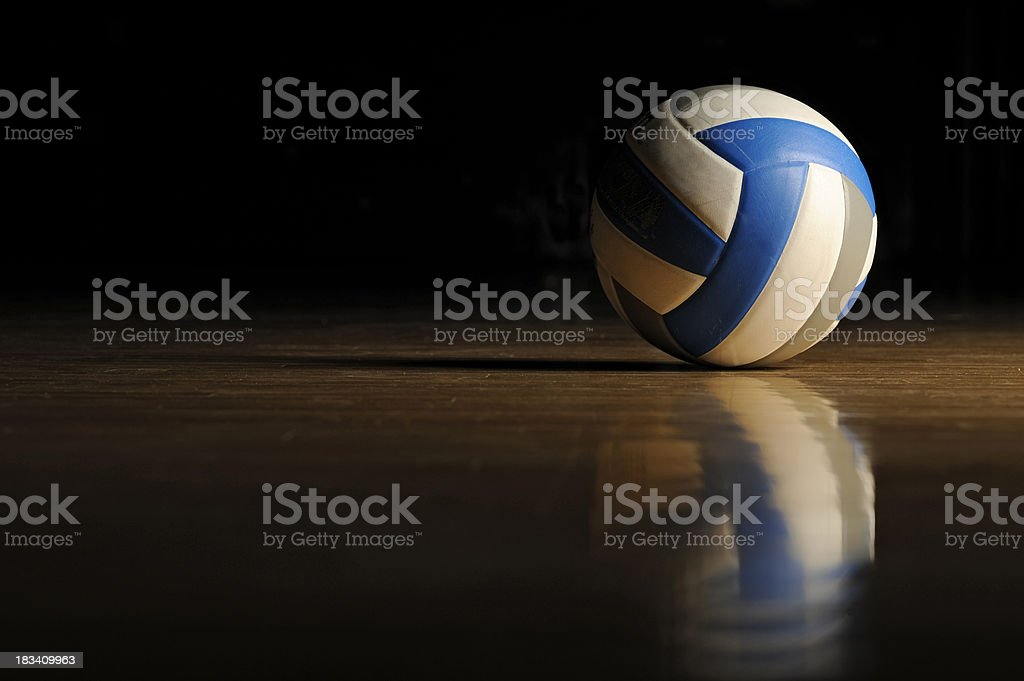 Volleyball on Wood Floor stock photo