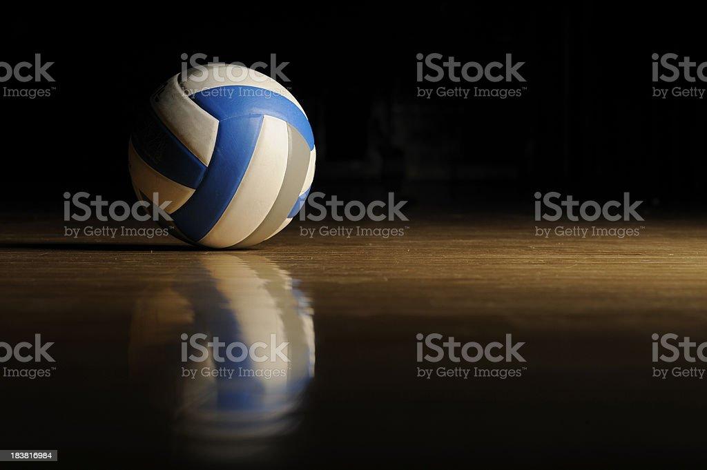 Volleyball on Wood Floor stock photo
