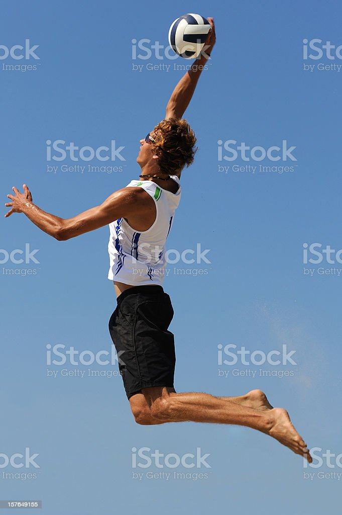 Volleyball player serving against blue sky royalty-free stock photo