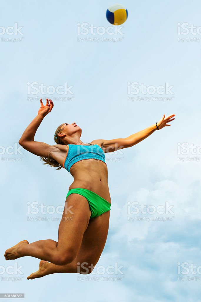 Volleyball Player Serving in Mid-air stock photo