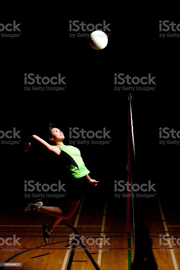 Volleyball Player Spiking the Ball stock photo