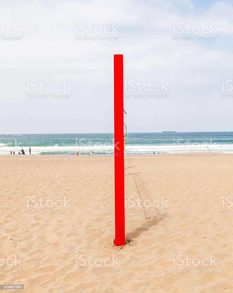 volleyball post at the beach in red stock photo