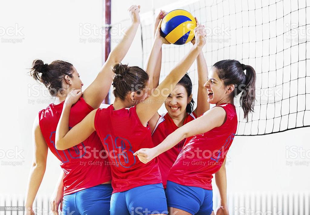Volleyball team celebrating after winning. royalty-free stock photo