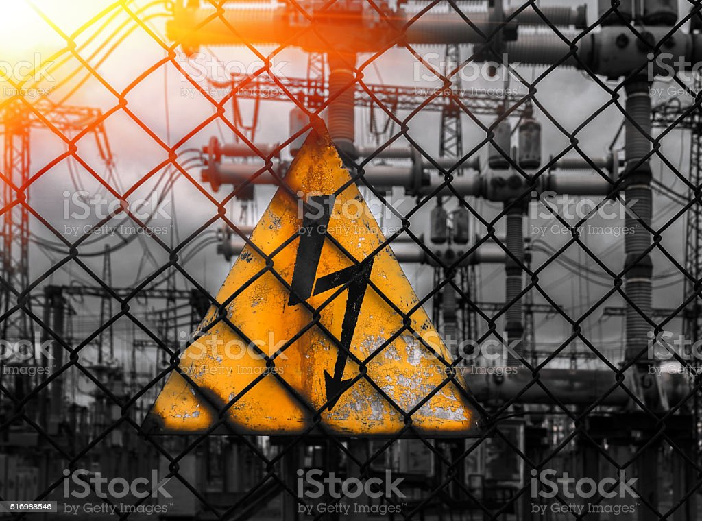 voltage sign on a background of power lines. top view. stock photo