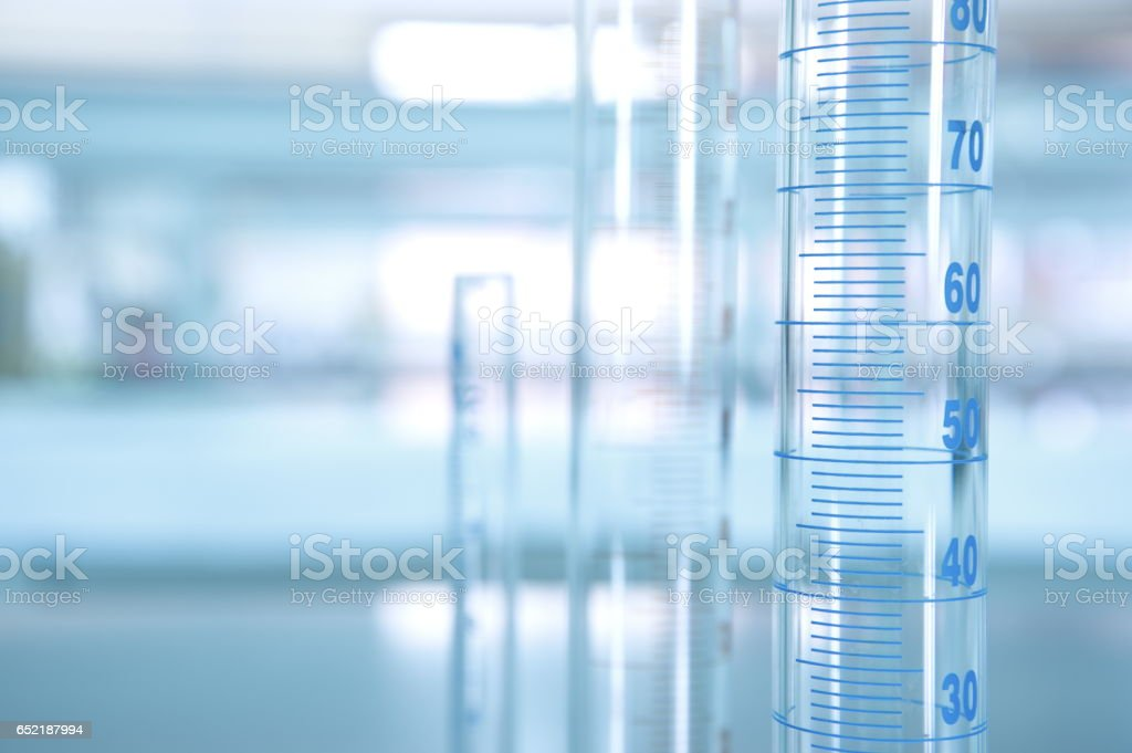 volume measuring cylinder in science laboratory stock photo