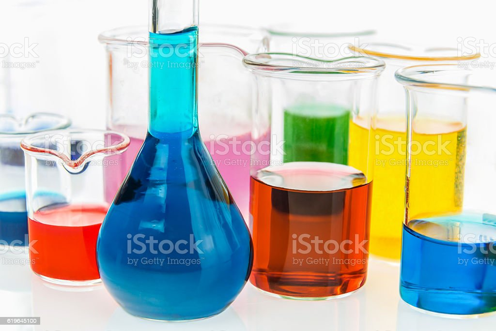 volumetric flask and beakers with different types of indicators stock photo