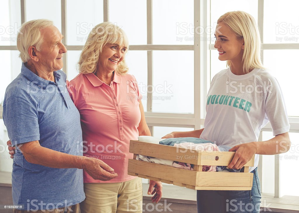 Volunteer and old people stock photo