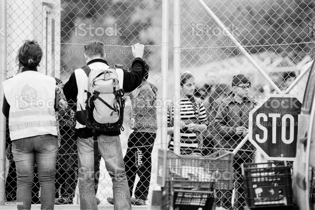 Volunteer and refugees at the Vial Detention Camp on Chios stock photo