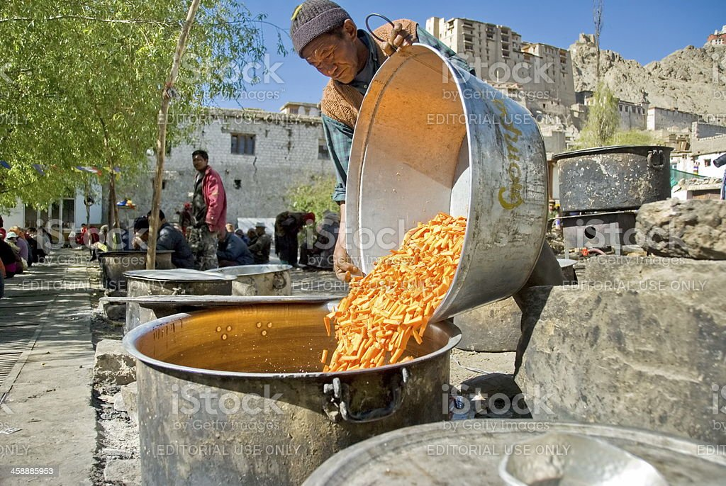 Volunteer cooks public soup at puja ceremony in Leh, India. royalty-free stock photo