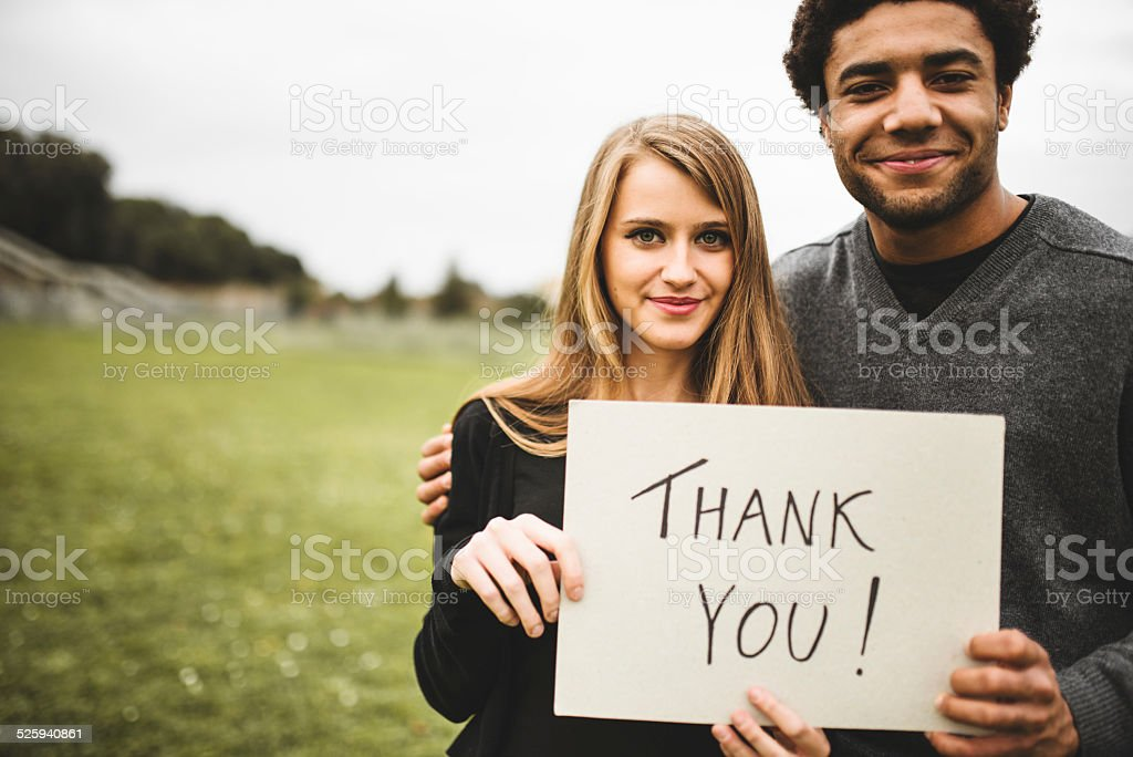 volunteer couple say thank you stock photo
