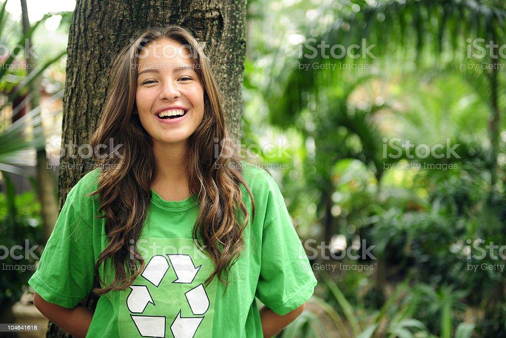 Volunteer: environmentalist wearing recycling t-shirt stock photo
