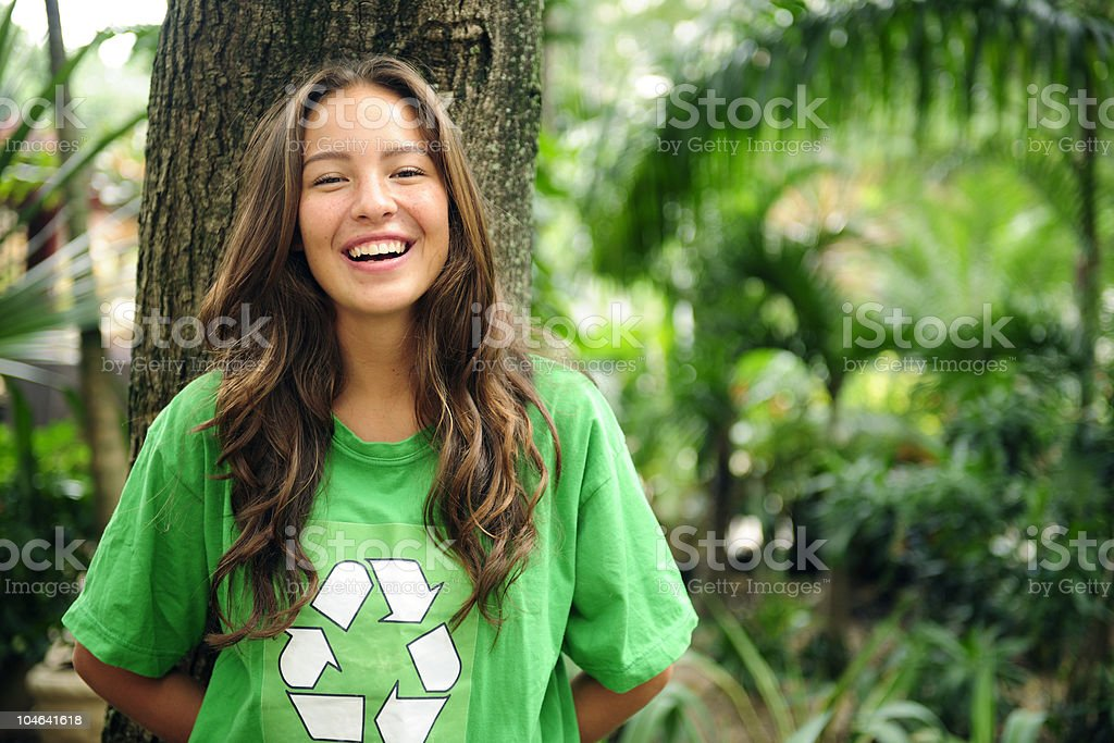 Volunteer: environmentalist wearing recycling t-shirt stock photo