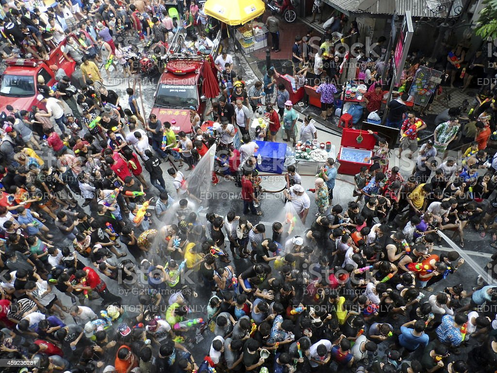 Volunteer fire fighters celebrate Songkran Festival with passerby stock photo