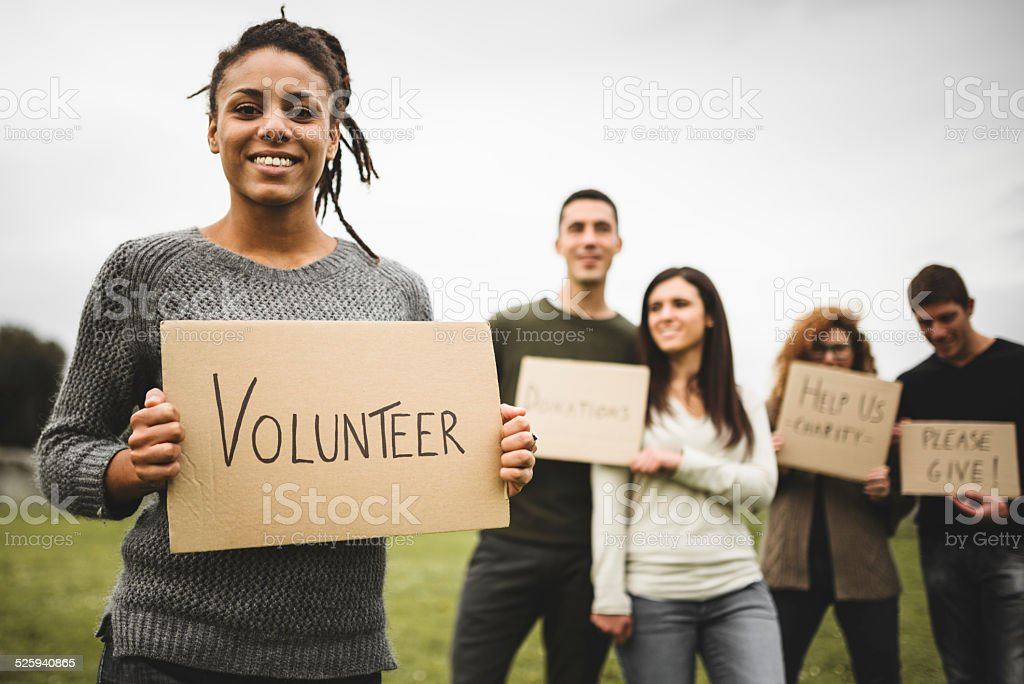 volunteer friends ask for donations stock photo
