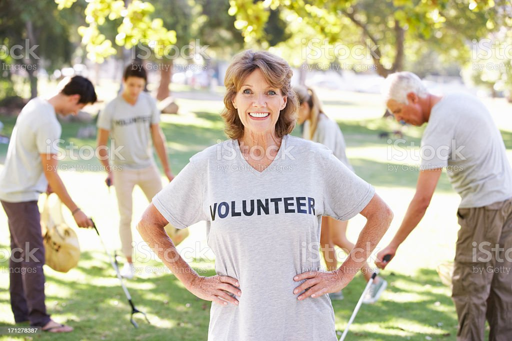 Volunteer Group Clearing Litter In Park stock photo