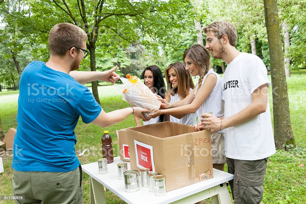 volunteer group receives food donation stock photo